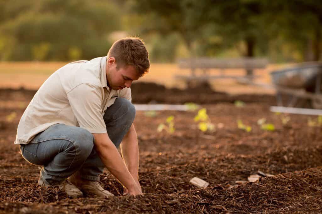 Man Making Hole in Soil